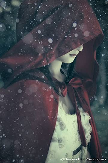 woman in a red cape: