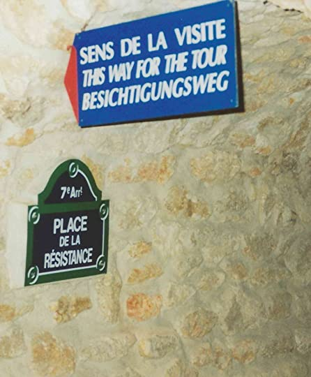 One of the historic stone walls of the Paris sewers, labeled with the name of the street above.