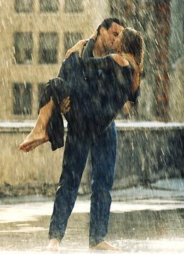Couple kissing in the rain: