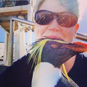 Liz hugging penguins is boring!