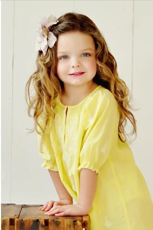cute little girl in yellow: