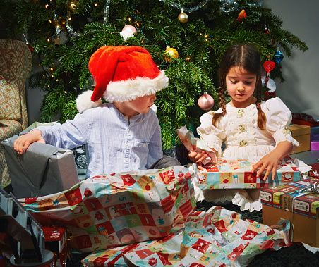 Children opening christmas gifts: