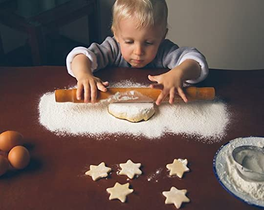 little boy decorating christmas cookies: