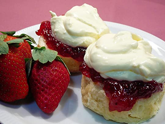 scones with jam and cream, with complimentary strawberries