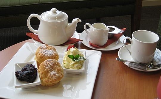 Tea with strawberry jam and cream scones and fresh strawberry