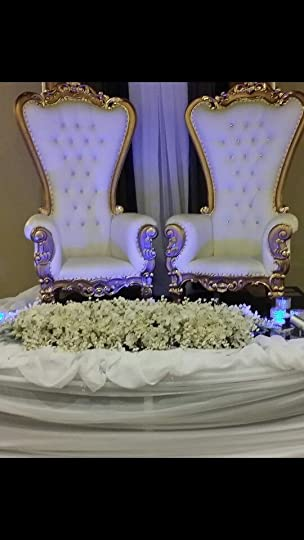 Thorn chairs with gold/silver accents.king and Queen wedding celebration.: