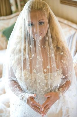 bride with veil over face: