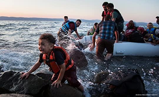 Syrian refugees arrive on Lesbos, Greece photo syrian-refugee-child-beach-600x367_1_zpsmecpxr9u.jpg
