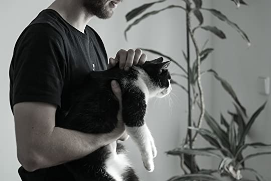 Image result for black and white cat man