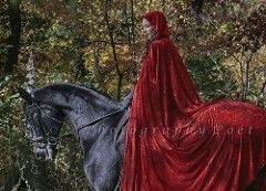 red caped woman on a horse:
