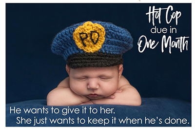 Picture of a baby wearing a police officer hat. Caption: He just wants to give it to her. She just wants to keep it when he