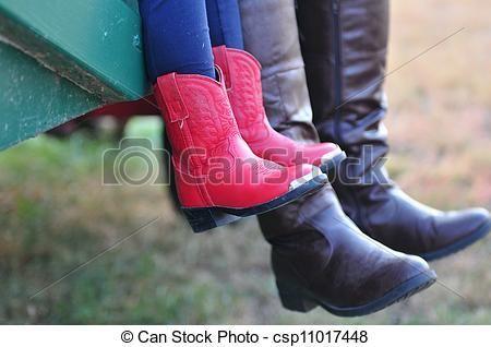 little girl wearing cowboy boots: