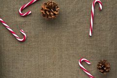 photo christmas-decorations-top-view-candy-canes-composition-cones-linen-fabric-background-63332161_zpsu4r0ff5m.jpg: