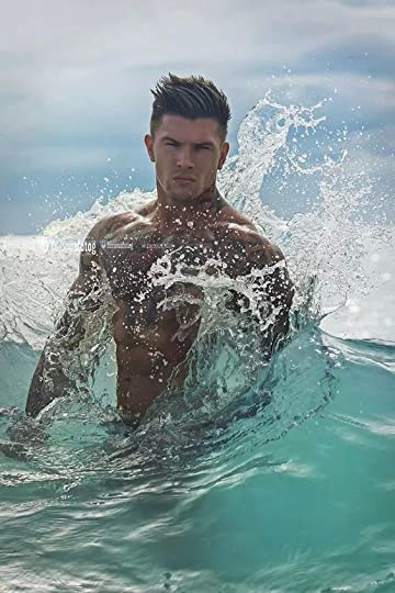 sexy man in the ocean: