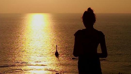 woman gazing at the ocean: