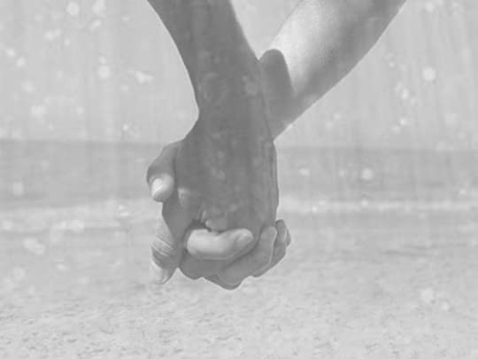 holding hands in the rain