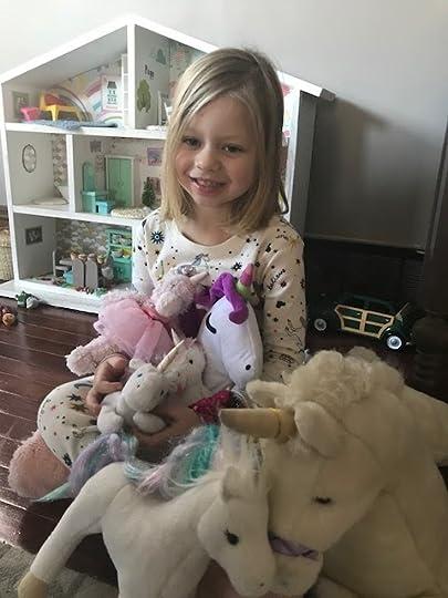 Picture of Poppy holding unicorns