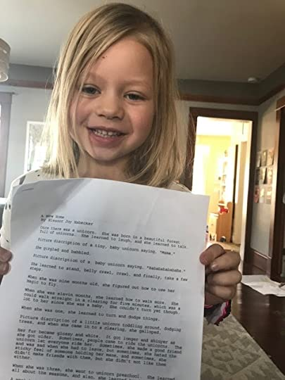 Poppy holding the story Eleanor wrote.
