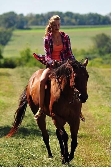 redhead woman riding horse bareback
