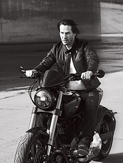 Keanu Reeves on a m;otorcycle