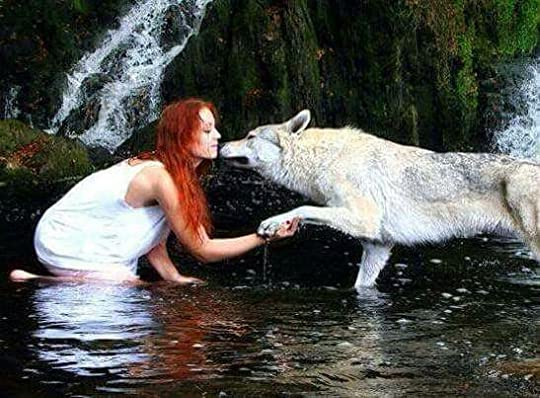 red haired woman with wolves