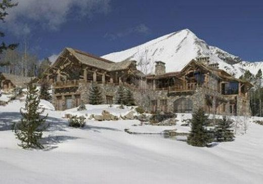 mansion on the mountain in the snow