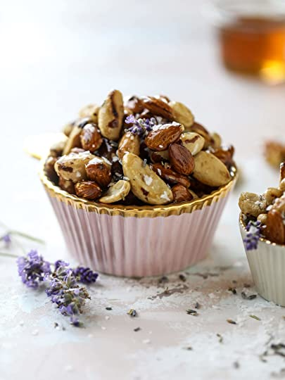These salted honey lavender nuts are the best snack to make for when you're on the go or when you need a perfect appetizer for your dinner party. Roasted, sweet and salty with a hint of lavender makes these irresistible! I howsweeteats.com #honey #lavender #nuts #salted #almonds #cashews #snacks #appetizers