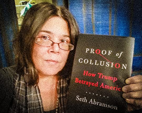 Picture of me holding Proof of Collusion