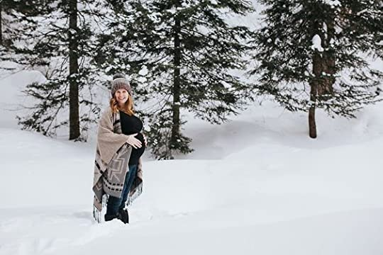beautiful blonde pregnant woman in the snow