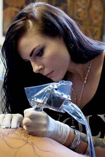 pretty female tattoo artist