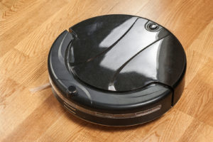 Odin is a robot vacuum cleaner one meter in diameter with a shiny black cover. He works for Danish seniors.