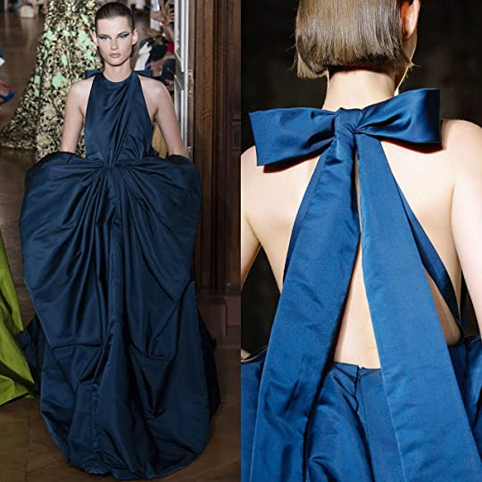 a0866338c8 The teal colored silk duchesse satin gown featured a draped halter neckline  with back tie bow