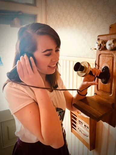 Girl on old fashioned phone
