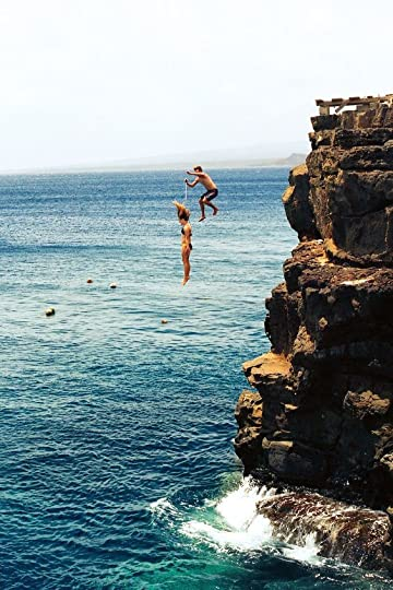 couple cliff diving