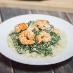Looking for a keto-friendly recipe, but sick of the same old bunless burgers and breakfast for dinner options? This simple pan-seared shrimp with cheesy spinach and cauliflower rice recipe is high fat, low carb, and 100% delicious!