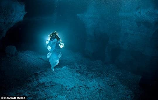 woman swimming in a cenote