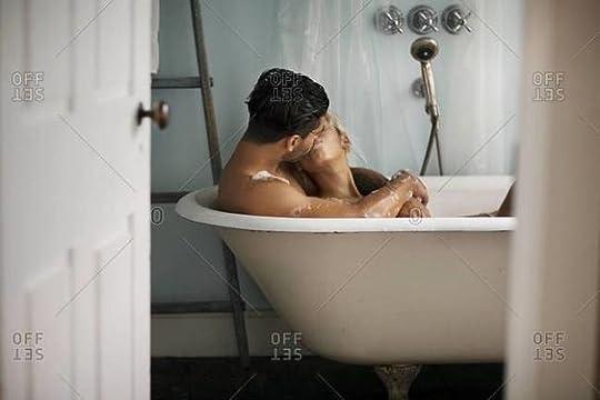 couple cuddles in bath tub