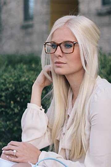 blonde professional woman in glasses