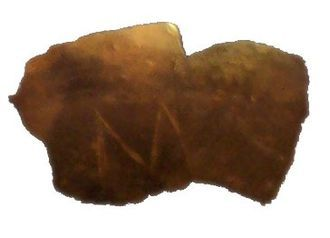 Fragment of a clay vessel with an M-shaped incision Neolithic Europe Vinča Serbia Danube 5,300 BC