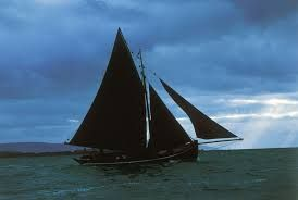 sail boat with black sails