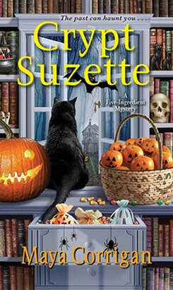 Cover of Crypt Suzette by Maya Corrigan with a black cat, jack o'lantern, candy corn, and shelves with books and Halloween decorationsPicture