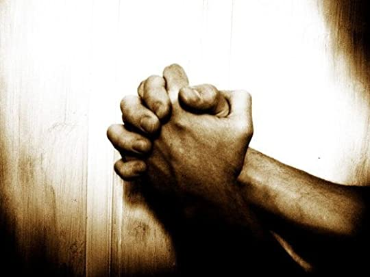 two mens hands clasping