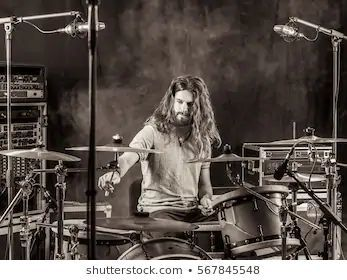 long haired male drummer