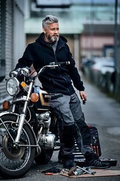 silver haired man on a motorcycle