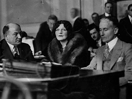 George Remus (left), his flapper daughter Romola (middle), and co-counsel Charles H. Elston (right) sit at the defendant's table during the sensational murder trial.