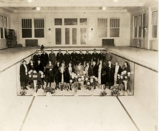 "George, Imogene, and Ruth pose with their guests for a formal portrait inside the famous ""Imogene Baths"" prior to it opening on December 31, 1921. Reports estimate that Remus paid up to $175,000 for the Grecian swimming pool, lined with tile from Cincinnati's famous Rookwood Pottery ."
