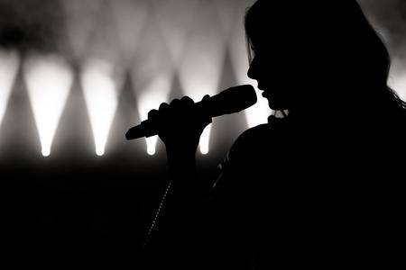 https://us.123rf.com/450wm/nagaets/nagaets1905/nagaets190500004/124628906-singer-in-silhouette-close-up-image-of-live-singer-on-stage.jpg?ver=6