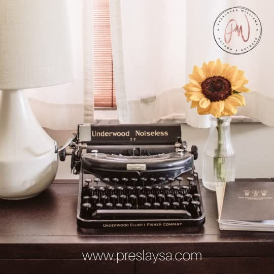 Picture of a typewriter with a flower