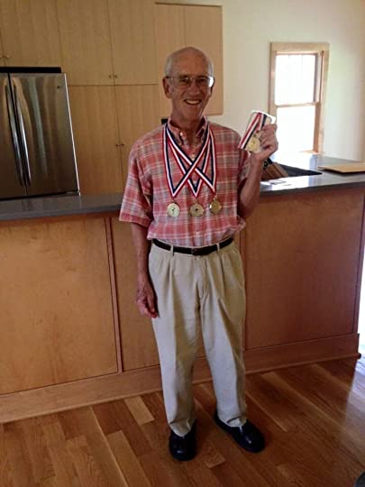 My dad, Lt. Cmdr. Gary Hosey, showing off his gold medals from the Greensboro Senior Olympics