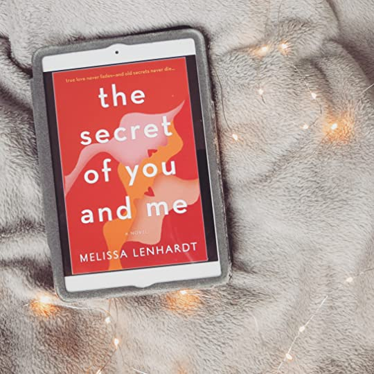 my bookstagram picture of the cover of the secret of you and me on an ipad with a blanket in the background